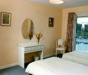 Twin bedroom with sit out Balcony over the River Killorglin Riverbank Lodges Kerry
